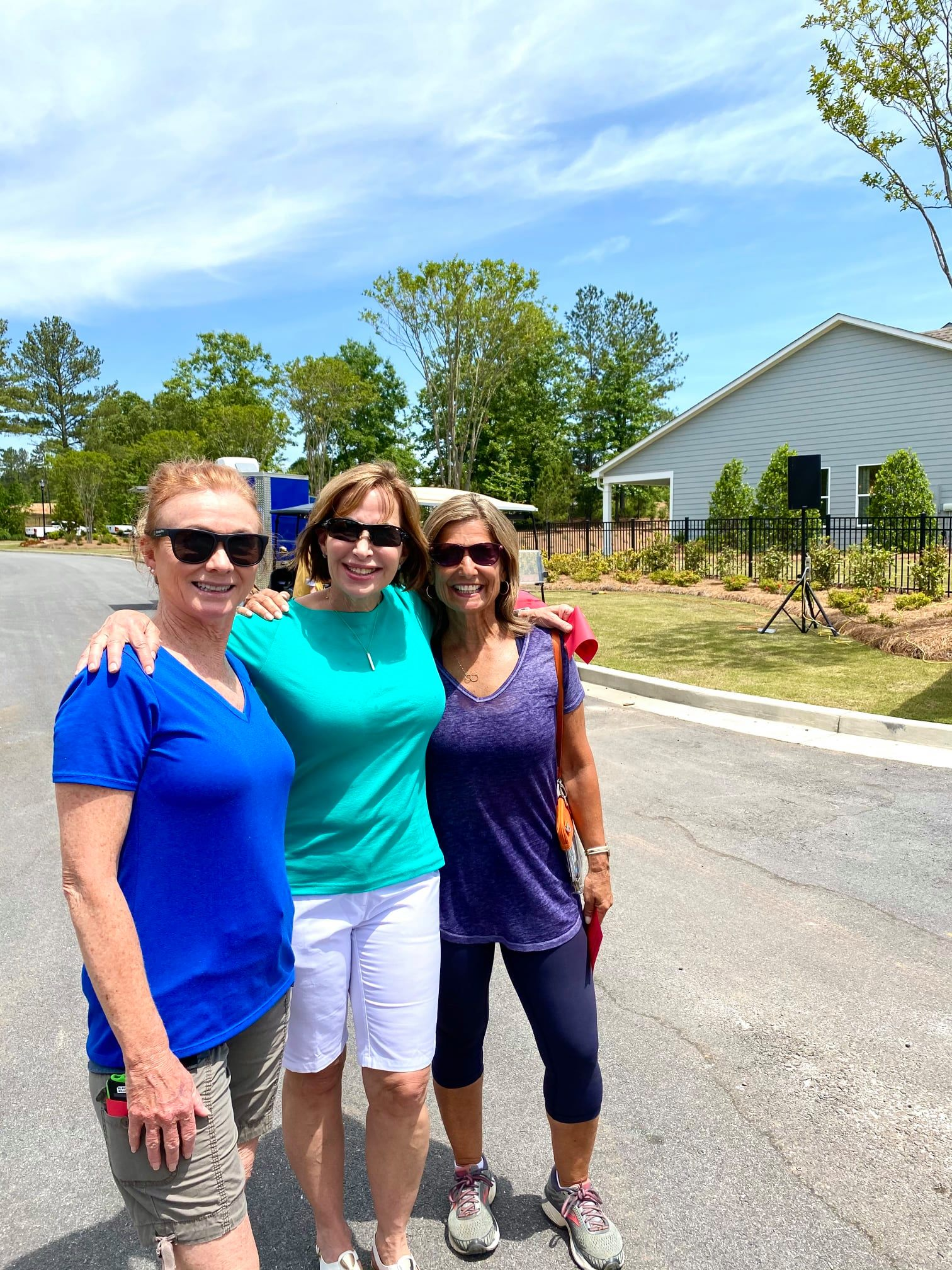 Cresswind Georgia residents posing and smiling at Hoschton Day in front of the model home park