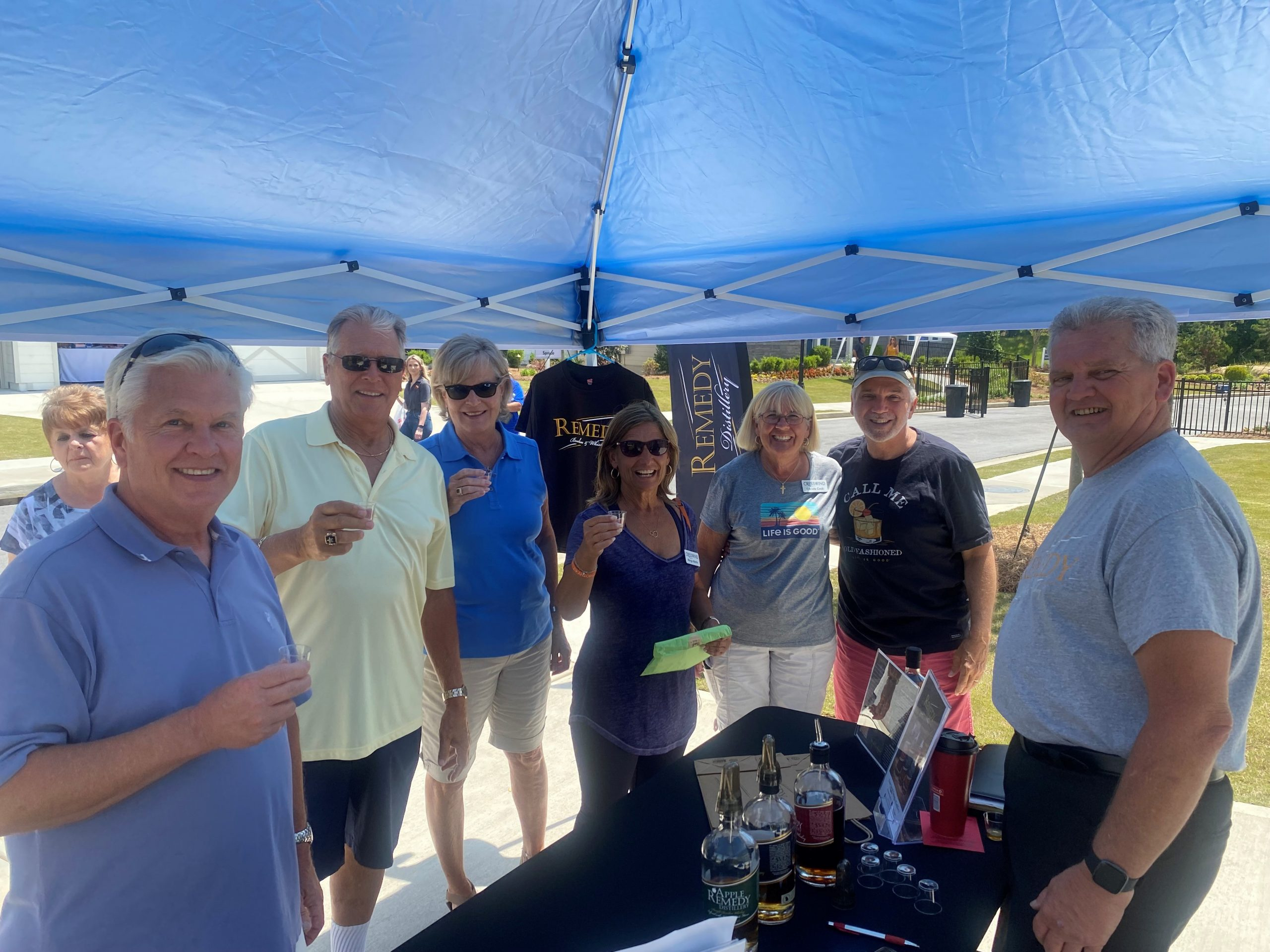 Cresswind Georgia residents gather around the Remedy Distillery table at Hoschton Day